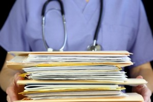 Doctor-holding-medical-files